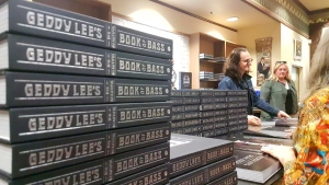 Geddy Lee, bassist for Canadian progressive rock band Rush, signs copies of 'Big Beautiful Book of Bass' at Bolen Books in Victoria Wed., May 22, 2019. (CTV Vancouver Island)