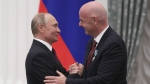 Russian President Vladimir Putin shakes hands with FIFA President Gianni Infantino in the Kremlin in Moscow, Russia, on May 23, 2019. (Evgenia Novozhenina / Pool Photo via AP)