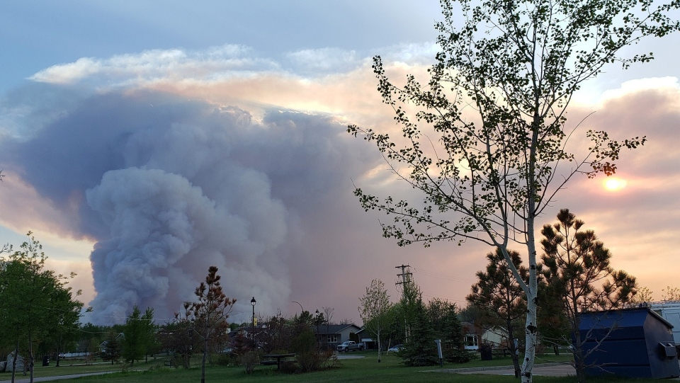 Smoke column can be seen from the Town of High Level, the evening of Tuesday May 21, 2019. (THE CANADIAN PRESS/HO-Government of Alberta)