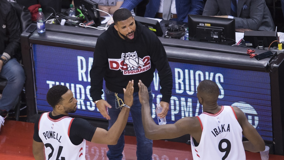 7eaf02d3ef2 Toronto Raptors forward Norman Powell (24) and Raptors centre Serge Ibaka  (9) celebrate with Drake, centre, while playing giants the Milwaukee Bucks  during ...
