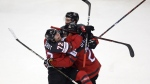 Damon Severson, right, celebrates after scoring his side's second goal during the Ice Hockey World Championships quarterfinal match between Canada and Switzerland at the Steel Arena in Kosice, Slovakia, on May 23, 2019. (Petr David Josek / AP)