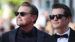Actors Leonardo DiCaprio, left, and Orlando Bloom pose for photographers upon arrival at the premiere of the film 'The Traitor' at the 72nd international film festival, Cannes, southern France, Thursday, May 23, 2019. (AP Photo/Petros Giannakouris)