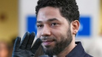 In this March 26, 2019, file photo, actor Jussie Smollett waves as he leaves Cook County Court after his charges were dropped in Chicago. (AP Photo/Paul Beaty)