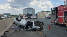 A vehicle after a Hwy. 401 rollover