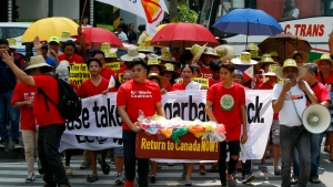 Environmentalists march outside the Canadian Embassy to demand the Canadian government to speed up the removal of several containers of garbage that were shipped to the country Tuesday, May 21, 2019, in Manila, Philippines. THE CANADIAN PRESS/AP, Bullit Marquez