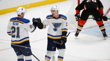 St. Louis Blues' Tyler Bozak, left, celebrates his goal with Jaden Schwartz during the third period of the team's NHL hockey game against the Anaheim Ducks on Wednesday, Jan. 23, 2019, in Anaheim, Calif. The Blues won 5-1. (AP Photo/Jae C. Hong)