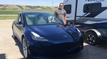 Jeffrey Leach and his new Tesla Model 3 (Cole Davenport / CTV Regina)