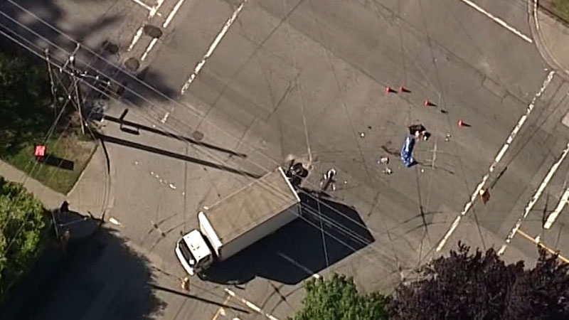 Motorcyclist in critical condition after collision with transport truck in Point Grey