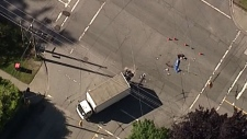 Vancouver police are investigating a serious collision involving a motorcycle and truck.