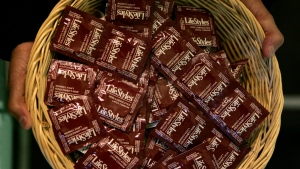 A basket of condoms is displayed in New York, Wednesday, Jan. 24, 2007. (AP Photo/Frank Franklin II)