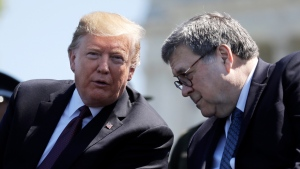 In this May 15, 2019, file photo, U.S. President Donald Trump and Attorney General William Barr speak at the 38th Annual National Peace Officers' Memorial Service at the U.S. (AP Photo/Evan Vucci, File)