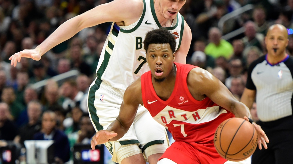 Milwaukee Bucks forward Ersan Ilyasova (77) defends against Toronto Raptors guard Kyle Lowry (7) during second half action in Game 5 of the NBA Eastern Conference final in Milwaukee on Thursday, May 23, 2019. THE CANADIAN PRESS/Frank Gunn