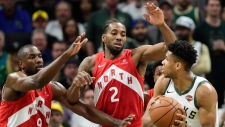 Toronto Raptors centre Serge Ibaka (9) and Toronto Raptors forward Kawhi Leonard (2) double team Milwaukee Bucks forward Giannis Antetokounmpo (34) during second half action in Game 5 of the NBA Eastern Conference final in Milwaukee on Thursday, May 23, 2019. THE CANADIAN PRESS/Frank Gunn