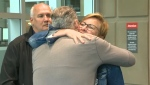 Brenda Wiese receives a hug from a supporter as her husband Jody looks on after their son Brett's killer was convicted of second-degree murder
