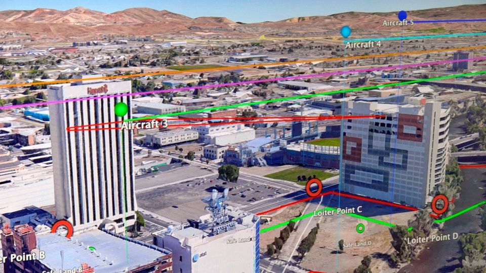 In this Tuesday, May 21, 2019 photo, a map in NASA's control room in downtown Reno, Nev., shows the flight patterns where researchers conducted the first drone tests of their kind in an urban setting. (AP Photo/Scott Sonner)