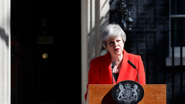 British Prime Minister Theresa May speaks in the street outside 10 Downing Street in London, England, Friday, May 24, 2019. (AP Photo/Alastair Grant)