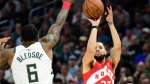 Toronto Raptors guard Fred VanVleet (23) shoots over Milwaukee Bucks guard Eric Bledsoe (6) during second half action in Game 5 of the NBA Eastern Conference final in Milwaukee on Thursday, May 23, 2019. THE CANADIAN PRESS/Frank Gunn