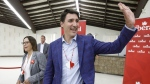 Prime Minister Justin Trudeau and Federal Liberal candidate Tammy Cook-Searson arrive during a visit to Meadow Lake, Saskatchewan, on May 23, 2019. (Jason Franson / THE CANADIAN PRESS)