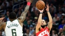 Toronto Raptors guard Fred VanVleet (23) shoots over Milwaukee Bucks guard Eric Bledsoe (6) during second half action in Game 5 of the NBA Eastern Conference final in Milwaukee on Thursday, May 23, 2019. (THE CANADIAN PRESS/Frank Gunn)