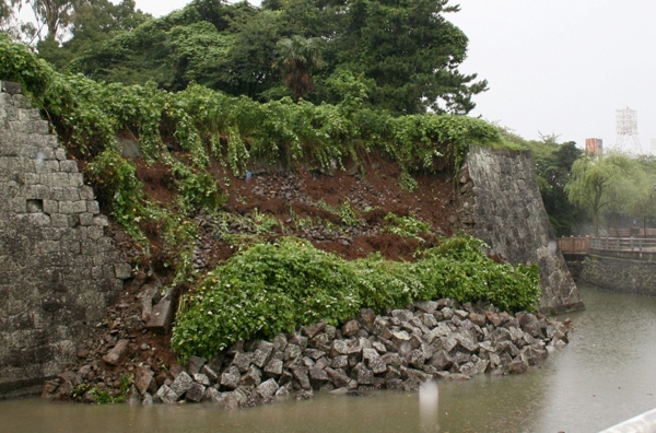 Parts of the stone wall of the Shizuoka Prefecture Office collapse in Shizuoka, Japan, after an early morning earthquake on Tuesday, Aug. 11, 2009. (AP / Kyodo News)