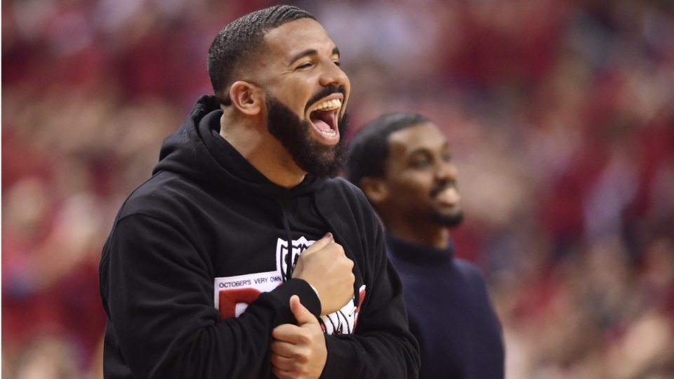 Drake smiles as he watches the Raptors take on the Milwaukee Bucks in Toronto on May 21, 2019. (Frank Gunn / THE CANADIAN PRESS)