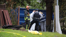 Emergency crews respond to a death at a Surrey, B.C. homeless camp on May 24, 2019.