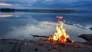 Bonfire by Cross Lake. Photo by Kara Muswagon.