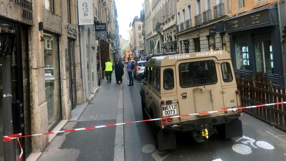 "A vehicle of French anti terrorist plan ""Vigipirate Mission"", is seen near the site of a suspected bomb attack in central Lyon, Friday May, 24, 2019. (AP Photo/Sebastien Erome)"