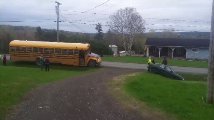 The driver of this school bus says the vehicle clipped the rear, right corner of the bus and drove along the shoulder of the road, nearly hitting the student trying to get on the bus before ending up in the ditch.