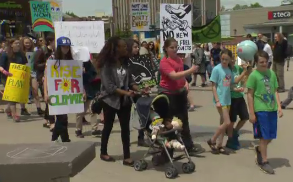 'We need to make them stop': Climate rally rolls through Waterloo
