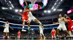Toronto Raptors' Kawhi Leonard shoots past Milwaukee Bucks' Brook Lopez during the second half of Game 5 of the NBA Eastern Conference basketball playoff finals Thursday, May 23, 2019, in Milwaukee. (AP Photo/Morry Gash)