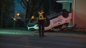 A turned-over car on the front lawn of a home on the corner of 13th Ave. and Osler St. as a result of a crash Friday night.