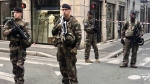 "Soldiers of French antiterrorist plan ""Vigipirate Mission"", secure the access near the site of a suspected bomb attack in central Lyon, Friday May, 24, 2019. (AP Photo/Sebastien Erome)"