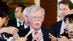 In this Friday, May 24, 2019, photo, then-U.S. National Security Adviser John Bolton is surrounded by reporters at the prime minister's official residence in Tokyo. (Yohei Kanasashi/Kyodo News via AP)