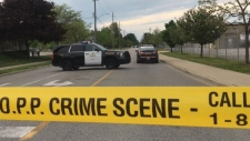 Ontario Provincial Police hold the scene of a crash involving a teenage cyclist on Lacasse Blvd. near Tecumseh Rd. on Friday May 24, 2019. (Photo via Twitter/@_OnLocation_)