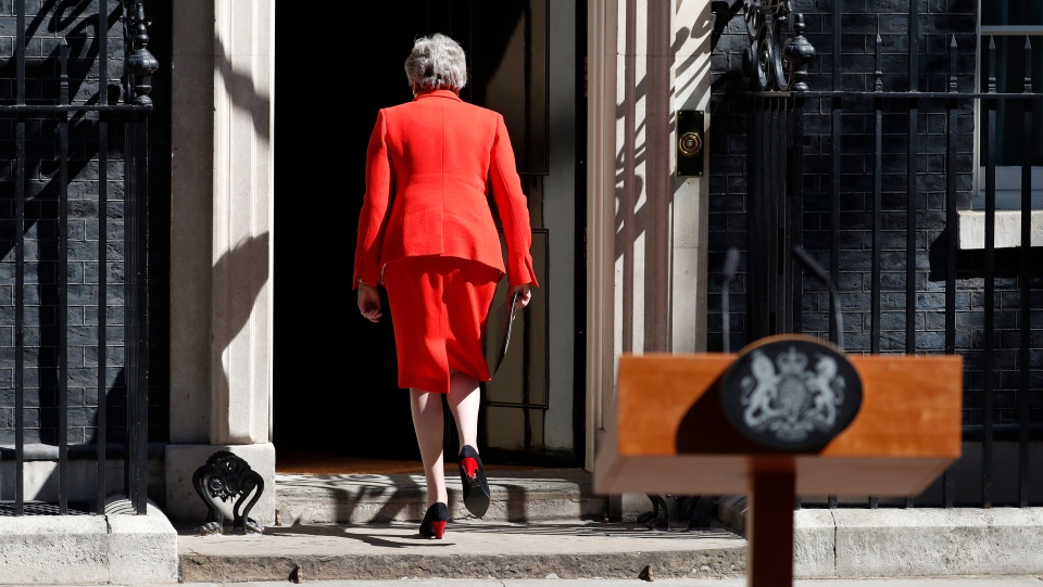 In this Friday, May 24, 2019 file photo, British Prime Minister Theresa May walks away after announcing her resignation, outside 10 Downing Street in London, England. (AP Photo/Alastair Grant, file)