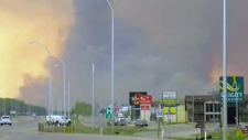 Crews monitoring path of Alberta wildfire