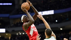 Toronto Raptors forward Pascal Siakam (43) is fouled by Milwaukee Bucks guard George Hill (3) during second half action in Game 5 of the NBA Eastern Conference final in Milwaukee on Thursday, May 23, 2019. THE CANADIAN PRESS/Frank Gunn