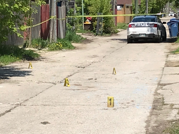 Police place markers on a Simcoe Street back lane on Saturday. (Source: Josh Crabb/ CTV News)