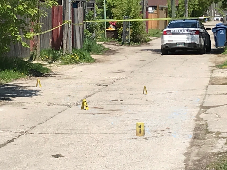 Police placed markers along a Simcoe Street back lane on Saturday. Josh Crabb/ CTV News