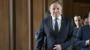 Quebec Premier Francois Legault leaves his office and walks to question period on April 3, 2019 at the legislature in Quebec City. (THE CANADIAN PRESS/Jacques Boissinot