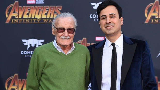 "FILE - In this April 23, 2018, file photo, Stan Lee, left, and Keya Morgan arrive at the world premiere of ""Avengers: Infinity War"" in Los Angeles. Morgan, the former business manager of Lee has been arrested on elder abuse charges involving the late comic book icon. (Photo by Jordan Strauss/Invision/AP, File)"