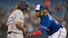 Toronto Blue Jays third baseman Vladimir Guerrero Jr. (27) tags out San Diego Padres' Josh Naylor trying to advance to third base on a Manny Machado single in the first inning of their interleague MLB baseball game in Toronto on Saturday May 25, 2019. THE CANADIAN PRESS/Fred Thornhill