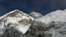 FILE - In this March 7, 2016, file photo, Mt. Everest, in middle, altitude 8,848 meters (29,028 feet), is seen on the way to base camp. (AP Photo/Tashi Sherpa, File)
