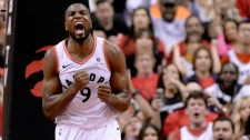 Toronto Raptors centre Serge Ibaka (9) reacts after dunking the ball during first half NBA Eastern Conference finals action against the Milwaukee Bucks, in Toronto on Saturday, May 25, 2019. (THE CANADIAN PRESS/Nathan Denette)