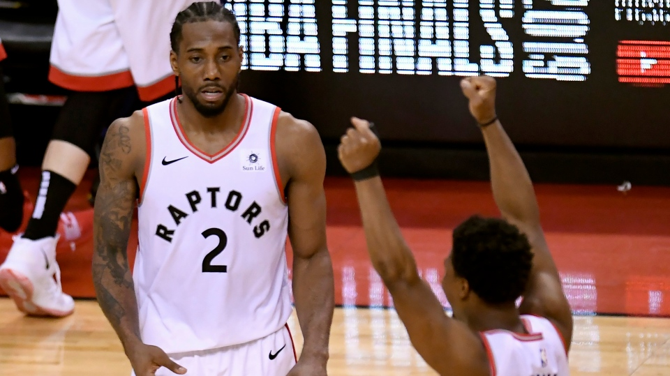 Toronto Raptors forward Kawhi Leonard (2) and teammate Kyle Lowry (7) react during second half NBA Eastern Conference finals action against the Milwaukee Bucks, in Toronto on Saturday, May 25, 2019. (THE CANADIAN PRESS/Frank Gunn)