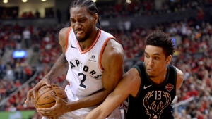 Toronto Raptors forward Kawhi Leonard (2) controls the ball under pressure from Milwaukee Bucks guard Malcolm Brogdon (13) during second half NBA Eastern Conference finals action in Toronto on Saturday, May 25, 2019. THE CANADIAN PRESS/Nathan Denette