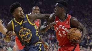 Toronto Raptors forward Pascal Siakam (43) drives to the basket against Golden State Warriors forward Jordan Bell (2) during the first half of an NBA basketball game in Oakland, Calif., Wednesday, Dec. 12, 2018. (AP Photo/Jeff Chiu)