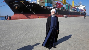 In this Dec. 3, 2017 file photo, Iranian President Hassan Rouhani poses during the inauguration a newly built extension of the port of Chabahar. (AP Photo/Ebrahim Noroozi, File )