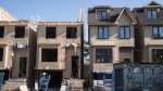Houses are shown under construction in Toronto on Friday, June 26, 2015. (THE CANADIAN PRESS/Graeme Roy)
